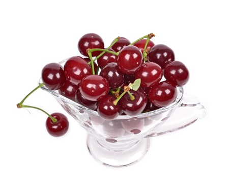 Ripe sour cherry  in a bowl, isolated on white  Stock Photo