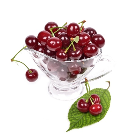 Ripe sour cherry in a bowl, isolated on white  photo