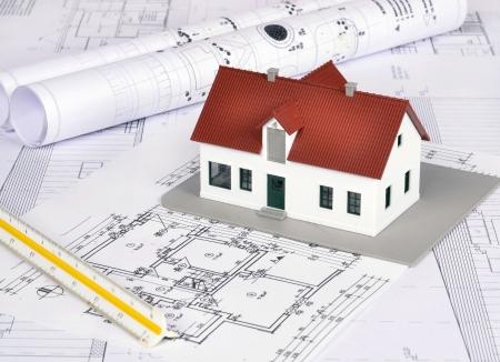 dimensions: model house on a construction plan for house building  Stock Photo