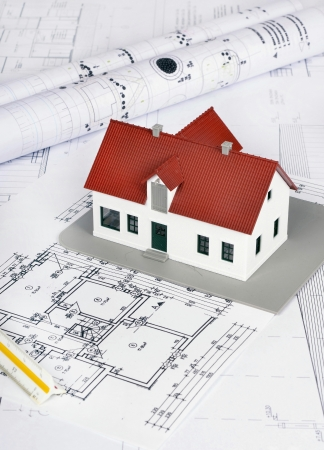 construction house: model house on a construction plan for house building  Stock Photo