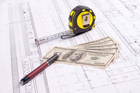 dollar banknotes on a construction plan for house building ,concept of buying a house  photo