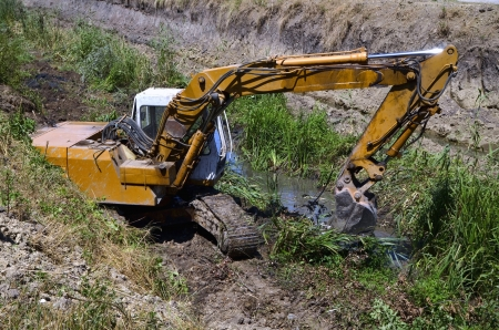 excavator along river Stock Photo