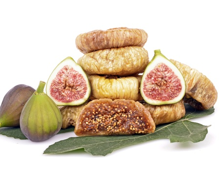 dried figs on the green leaves  Stock Photo