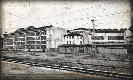 industry moody:  Old locomotive in old abandoned train workshop in retro design look