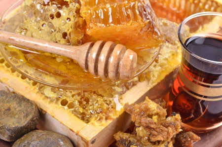 fresh  honeycombs  and wooden stick ,cup of Turkish tea,propolis, isolated on white background