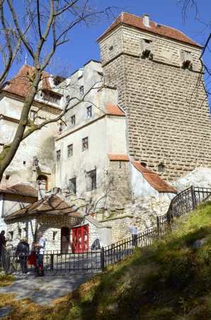 BRAN, ROMANIA - October 12: Visitors admire the Bran Castle, also called Draculas Castle October 12, 2013 in Bran, Romania     photo