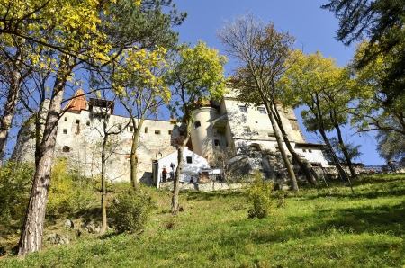 BRAN, ROMANIA - October 12: Visitors admire the Bran Castle, also called Draculas Castle October 12, 2013 in Bran, Romania