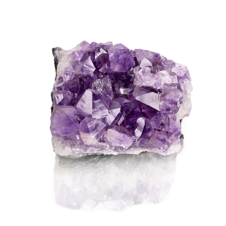 purple rough amethyst crystals isolated on white  Stock Photo