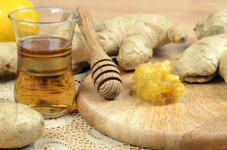 Fresh  ginger ,  tea and fresh honey, spice on wooden table  photo
