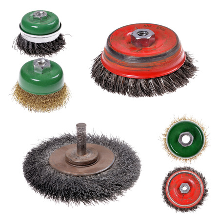 rotating metal brush or grinding disc,  isolated on the white background photo