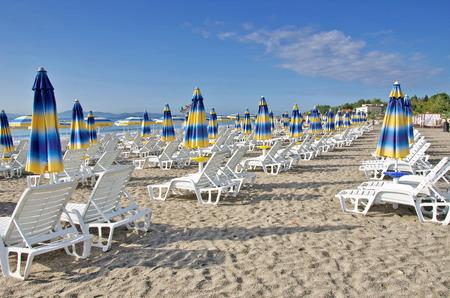 Beach chairs and umbrellas on the beach the Black Sea, Bulgaria photo