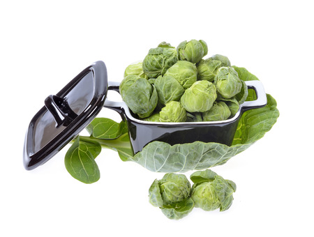 compromised: brussels sprouts compromised in a porcelain vessel  isolated on white background