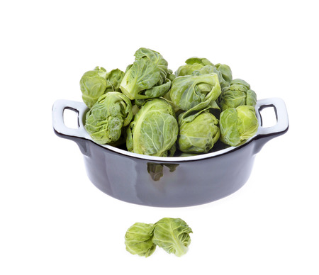compromised: brussels sprouts compromised in a porcelain vessel isolated on white background Stock Photo