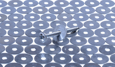 essentially: screw  and washers closeup on isolated  white background