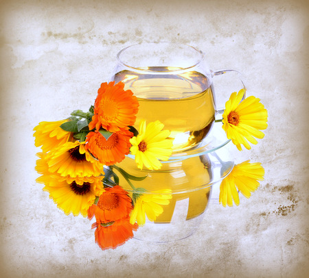 nontraditional: Herbal calendula tea in glass cup,reflection,texture