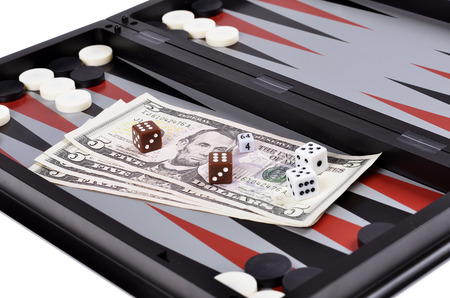 Dollar bills with dice on the   backgammon photo
