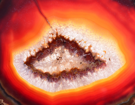 detail of agate(mineral) texture in red color, polished cut Stock Photo