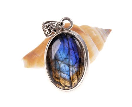 labradorite: silver jewelry pendant with a stone (mineral) Labradorite   on snail shell Stock Photo