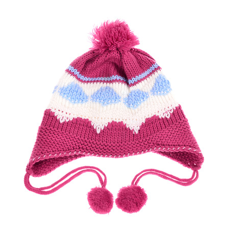 tassel: knit hat for little girls, with tassel and neck strap on white background