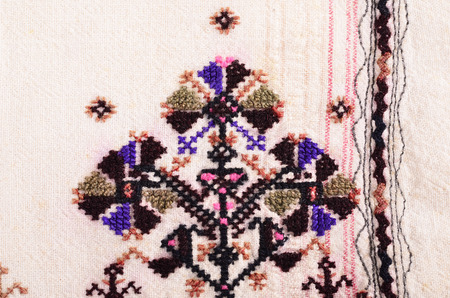 sewn up: Bulgarian hand embroidery texture in old style with silk  thread on cloth woolen