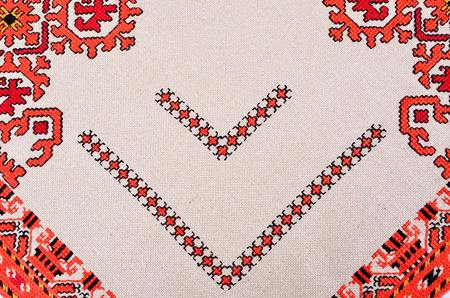 fancywork: POPOVO, BULGARIA - December 26, 2015 - Ethnographic Museum folklore female national costume and embroideries in Popovo, Bulgaria.Bulgarian hand embroidery texture in old style with silk thread
