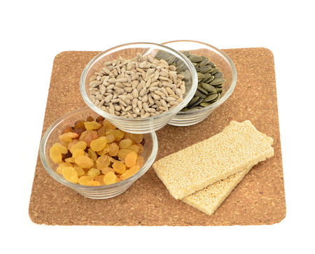 energy bar: Sesame seed ,pumpkin, sunflower seeds, raisins and nut energy bar, white background.