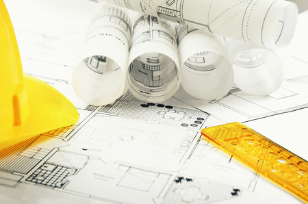 yellow helmet: Architectural project and yellow helmet Stock Photo