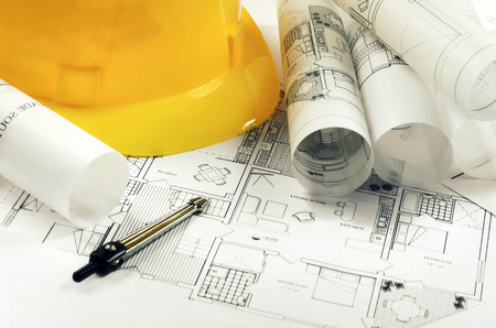 Architectural project and yellow helmet Stock Photo