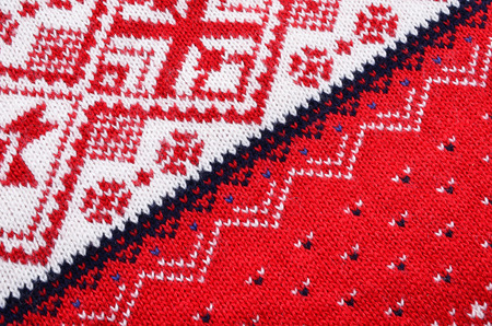 warm cloth: Macro red  knitting  fabric wool, material texture for background ,structure knitting