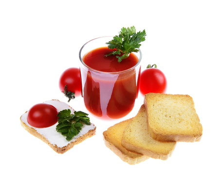 glass full of freshly prepared tomato juice isolated on white background