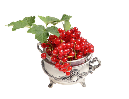 Red currants In a metal bowl on a white background