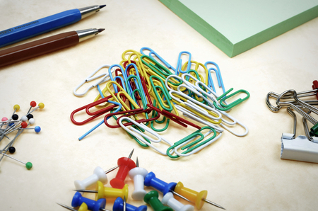 Assorted colorful stationery on old paper Stock Photo