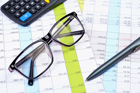 Business concept with calculator, pen,  glasses ,money and documents.Selective focus