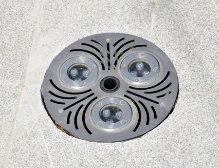 Round sewer grating with  floor drainage for rainwater  in the park