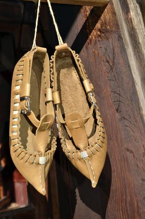 Traditional Bulgarian leather folklore shoes - tsarvuli. Handmade.Selective focus.