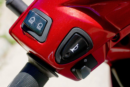 Switches control various functions on an motorcycle .light and horn switch of motorcycle . Stock Photo