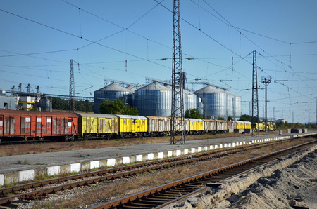 Railway tracks,old wagons and silos