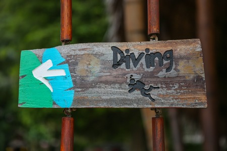 Vintage looking Diving sign with an arrow pointing direction