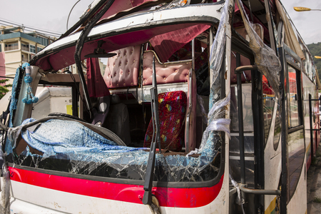 Bus crashed into a wall. broken glass.