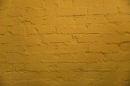 Background of old yellow brick wall texture Фото со стока