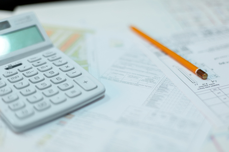 Rolled electrical diagrams, calculator, pencils and mathematical calculations for project, drawings for the projects engineer jobs Фото со стока