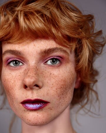 Portrait of cute beautiful young girl with freckles close-up Standard-Bild