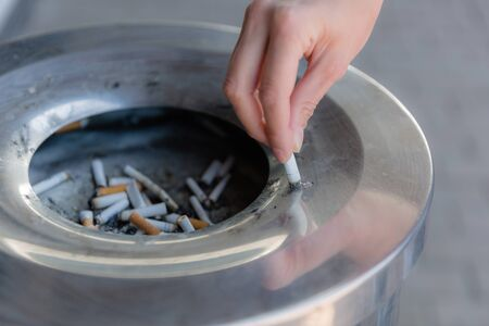 Cigarette butts in the urn, close-up.