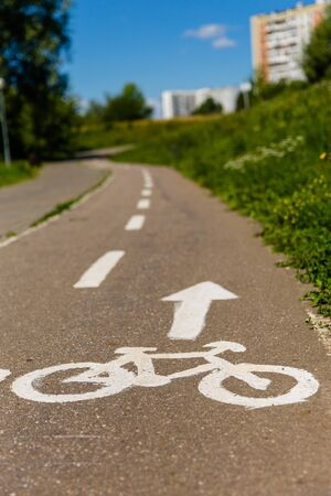 Bicycle lane mark on the city cycle lane in summertime.