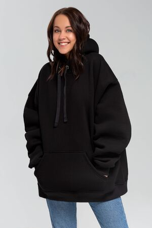 Woman in black oversize hoodie, mockup for logo or branding design