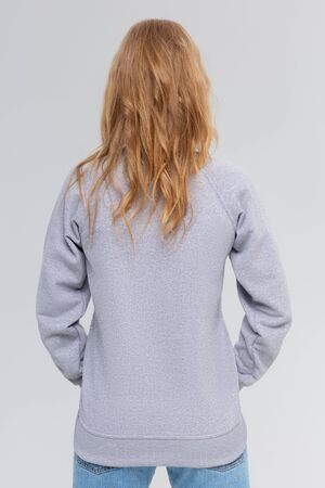 Blank sweatshirt mock up isolated. Female wear plain hoodie mockup. Plain hoody design presentation. Clear loose overall model. Pullover for print. Woman clothes sweat shirt template sweater wearing