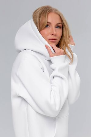 Woman in white hoodie, mockup for logo or branding design Foto de archivo