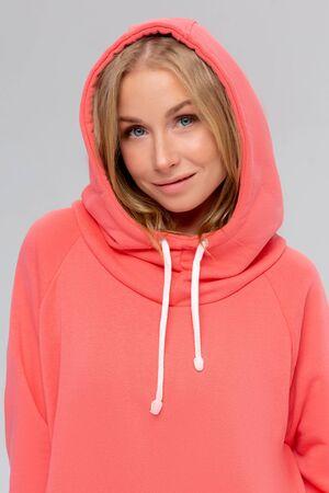 Woman in pink long hoodie, mockup for branding design Foto de archivo