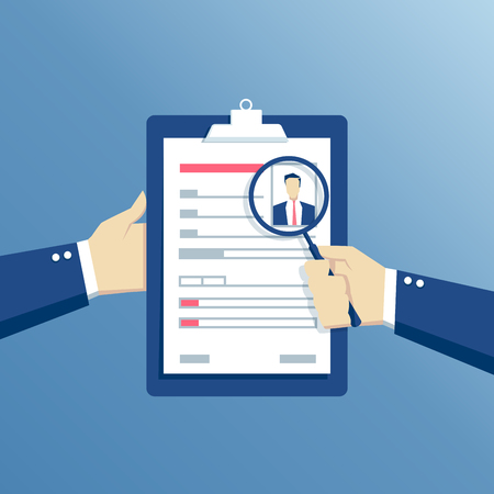 Job interview and recruitment business concept, hands holding a resume and see it through a magnifier, analysis of questionnaire