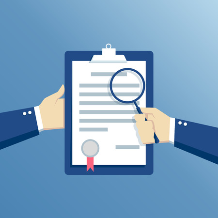 preparation: Business concept contract inspection, hands holding the contract and examine its conditions through a magnifying glass
